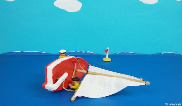 Das leichtere Crewmitlgied kann jetzt das Schwert loslassen und schwimmt um das Boot herum.